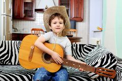 Boy with a guitar Stock Image