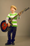 The boy with a guitar Royalty Free Stock Photography