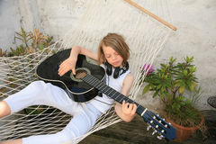 Boy and guitar Stock Images