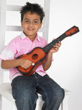 Boy with guitar Stock Images
