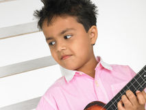 Boy with guitar Stock Photo