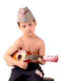 Boy with a guitar. Boy in military uniform with a guitar royalty free stock photos