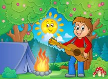 Boy guitar player in campsite theme 1 Royalty Free Stock Images