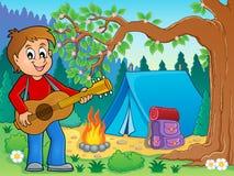 Boy guitar player in campsite theme 2 Stock Photos