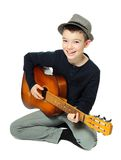 Boy with a guitar Stock Images