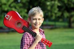 Boy with guitar portrait Stock Photo