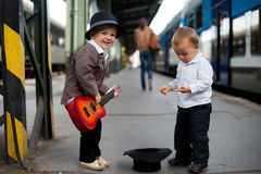 Boy with a guitar on a railway station Royalty Free Stock Image