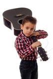 Boy with guitar on shoulder Stock Image