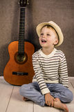 Boy and guitar Stock Photography