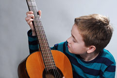Boy with guitar Stock Image