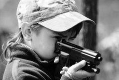 Boy with a gun Stock Photography