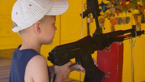 Boy with a gun stock video