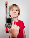 Boy with gun toy Royalty Free Stock Image