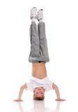 Boy gymnastic. Happy little boy gymnastic acrobatics equilibrium posture isolated on white background Stock Photo