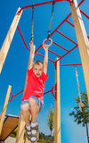 Boy on the gymnastic rings Stock Images