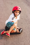 Boy with a gyro scooter, outdoors Royalty Free Stock Image