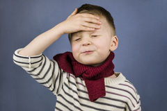 The boy had a headache. On a blue background Stock Image
