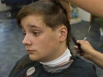 Boy hair cut. Boy having a hair cut at the hairdressers Stock Photography