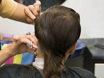 Boy hair cut. Boy having a hair cut at the hairdressers Royalty Free Stock Photos