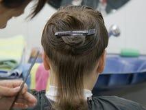 Boy hair cut. Boy having a hair cut at the hairdressers Royalty Free Stock Photo