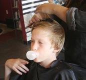 Boy Haircut. Boy getting his hair cut at a popular salon and barbershop Royalty Free Stock Images