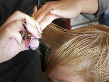 Boy Haircut. Boy getting his hair cut at a popular salon and barbershop Royalty Free Stock Photo