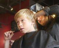 Boy Haircut. Boy getting his haircut at a popular salon and barbershop Royalty Free Stock Images