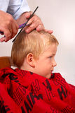 Boy at the hairdresser Stock Images