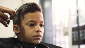 Boy at hairdresser`s stock video footage
