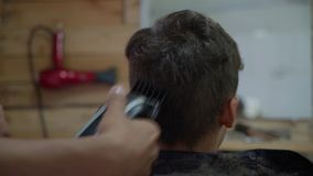 Boy at hairdresser`s stock video
