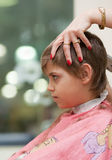 Boy at hairdresser's shop. Boy getting a haircut at barber shop Royalty Free Stock Images