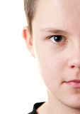 Boy half face. Portrait of a boy, half face isolated on white royalty free stock photography