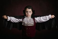 Boy in Halloween. Boy dressed as a vampire. Boy in Halloween. Boy dressed as a vampire on dark background Royalty Free Stock Photos