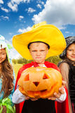 Boy in Halloween costume with hat makes face Royalty Free Stock Images