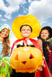 Boy in Halloween costume makes face Royalty Free Stock Images