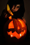 Boy in halloween costume with pumpkin head Royalty Free Stock Image