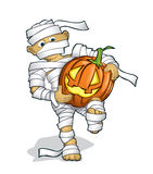 Boy in a halloween costume with a pumpking Royalty Free Stock Images