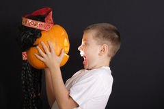 Boy and halloween pumpkin Stock Photos