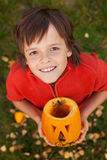 Boy with a Halloween pumpkin jack-o-lantern Royalty Free Stock Images