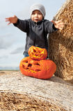 Boy and halloween pumpkins Royalty Free Stock Image