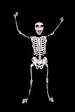 Boy in Halloween skeleton costume Royalty Free Stock Image