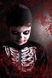 Boy in Halloween skeleton costume Royalty Free Stock Photo