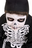 Boy in Halloween skeleton costume Royalty Free Stock Images