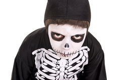 Boy in Halloween skeleton costume Stock Images