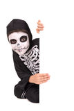 Boy in Halloween skeleton costume Stock Photos