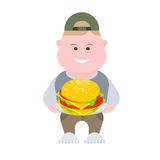 Boy with a hamburger Stock Image