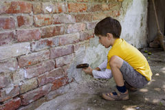 Boy with hammer Royalty Free Stock Images