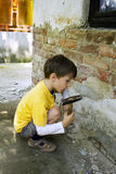 Boy with hammer Stock Photo
