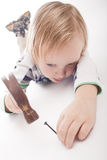 Boy with hammer and nail Royalty Free Stock Images