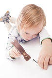 Boy with hammer and nail Royalty Free Stock Image